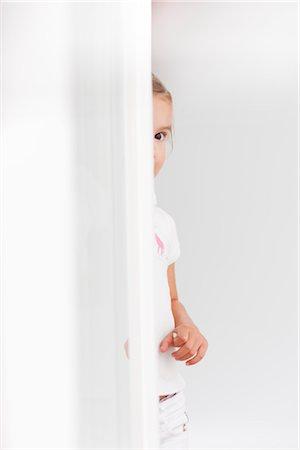 Child peeking corner Stock Photos - Page 1 : Masterfile