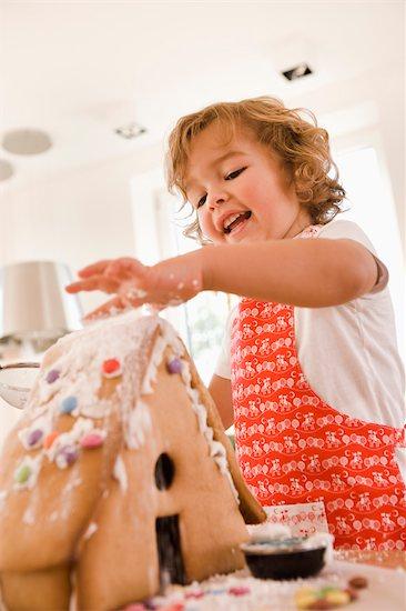 Young boy baking cake house Stock Photo - Premium Royalty-Free, Image code: 649-03362618