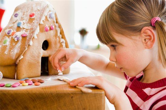 young girl preparing cake house Stock Photo - Premium Royalty-Free, Image code: 649-03362641