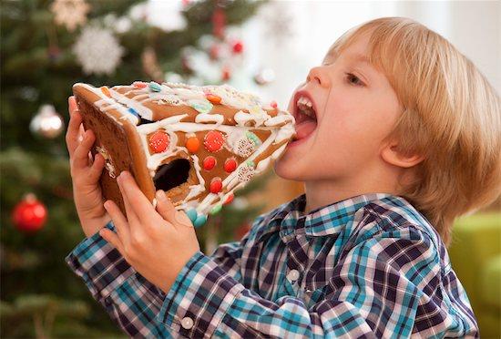 boy eating gingerbread house Stock Photo - Premium Royalty-Free, Image code: 649-03417645