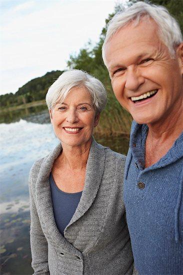 Senior couple in front of lake Stock Photo - Premium Royalty-Free, Image code: 649-03769283