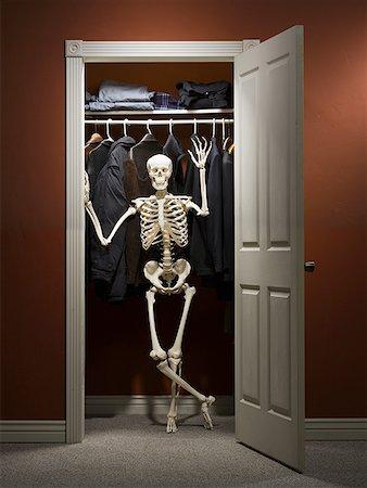 skeletons closet - Skeleton standing in closet waving Stock Photo - Premium Royalty-Free, Code: 640-01365967