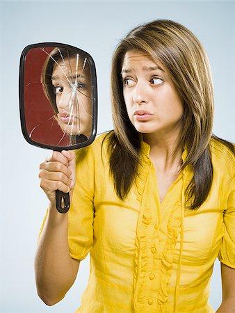 someone looking into a broken mirror stock photos - page 1 : masterfile