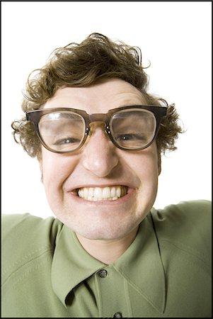 9e241fd8b7c6 dorky guy - Man posing Stock Photo - Premium Royalty-Free