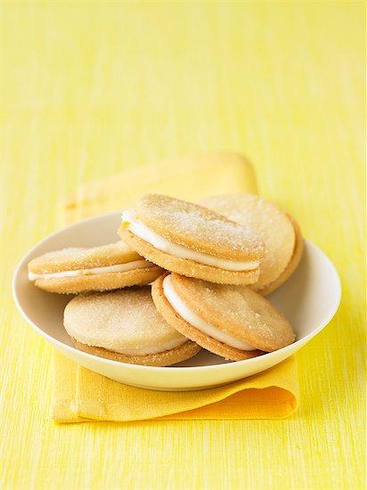 Cream-filled lemon biscuits Stock Photo - Premium Royalty-Free, Image code: 659-06495321