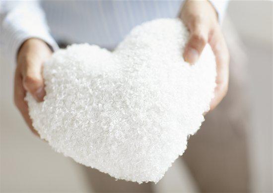 Heart shaped cushion Stock Photo - Premium Royalty-Free, Image code: 670-03709983