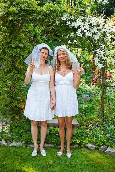 Two brides in garden Stock Photo - Premium Royalty-Free, Image code: 673-03005509