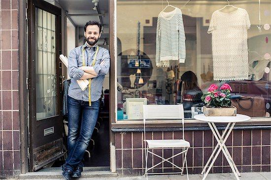 Portrait of confident mid adult male designer standing at studio entrance Stock Photo - Premium Royalty-Free, Image code: 698-06966437