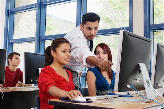 Teacher Explaining Something to Students Stock Photo - Premium Royalty-Free, Image code: 693-06021058