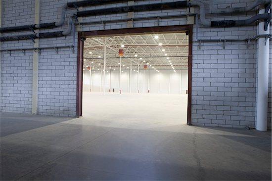 Access door to empty warehouse Stock Photo - Premium Royalty-Free, Image code: 693-03440852