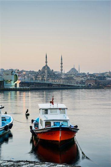 Turkey, Marmara, Istanbul, Galata Bridge and Yeni Mosque, Boats at Dawn Stock Photo - Premium Rights-Managed, Artist: Siephoto, Image code: 700-06732692