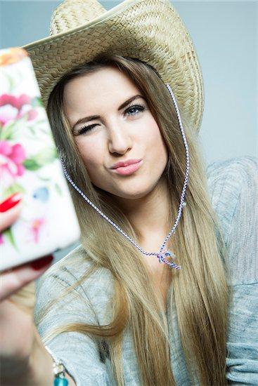 Young Woman taking Selfie, Studio Shot Stock Photo - Premium Rights-Managed, Artist: Uwe Umstätter, Image code: 700-07562376