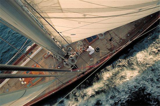 Man Trims Sails aboard Shamrock V while Sailing in Narragansett Bay, Newport, Rhode Island, USA Stock Photo - Premium Rights-Managed, Artist: Michael Eudenbach, Image code: 700-07965861