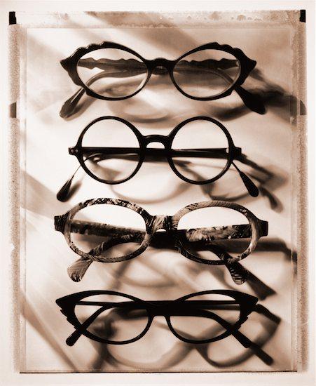 Row of Eyeglasses Stock Photo - Premium Rights-Managed, Artist: Michael Kohn, Image code: 700-00029229