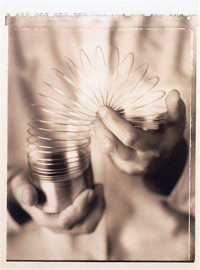 Hands Holding Spring Stock Photo - Premium Rights-Managed, Artist: Michael Kohn, Image code: 700-00035072