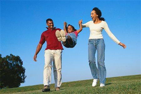 Family Walking Outdoors Stock Photo