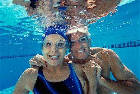 Senior Woman Underwater Stock Photos