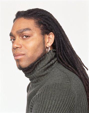 Dreadlocks And Hoop Earrings Portrait Of Man Wearing Turtleneck Stock Photo Rights Managed