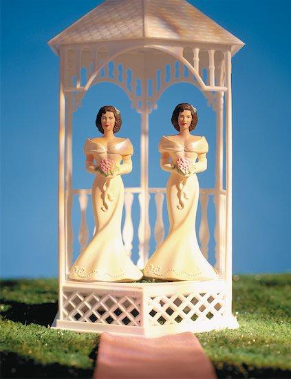 Two Bride Figurines Standing In Gazebo Stock Photo - Premium Rights-Managed, Artist: Elizabeth Knox, Image code: 700-00085026