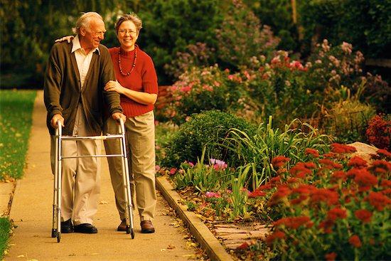 Mature Couple Walking in Garden Stock Photo - Premium Rights-Managed, Artist: Richard Smith, Image code: 700-00099915