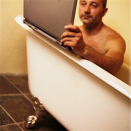 Laptop bathtub Stock Photos - Page 1 : Masterfile