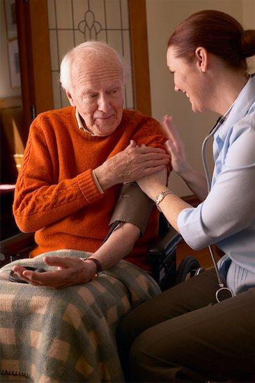 Woman Taking Man's Blood Pressure Stock Photo - Premium Rights-Managed, Artist: Dan Lim, Image code: 700-00341072