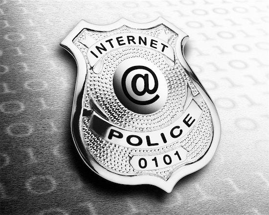 Police Badge Displaying @ Symbol Stock Photo - Premium Rights-Managed, Artist: Boden/Ledingham, Image code: 700-00350676