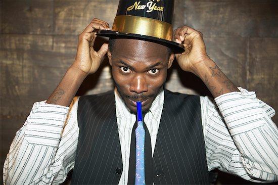 Man Celebrating the New Year Stock Photo - Premium Rights-Managed, Artist: Masterfile, Image code: 700-00544222