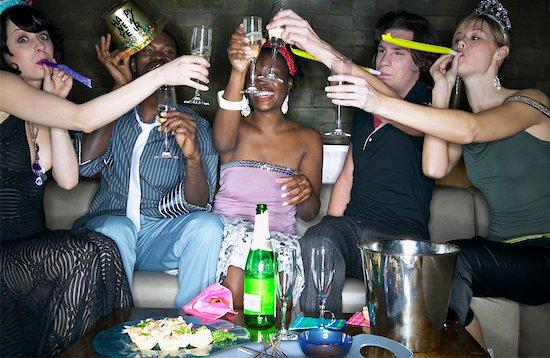 Friends Celebrating Stock Photo - Premium Rights-Managed, Artist: Masterfile, Image code: 700-00544231