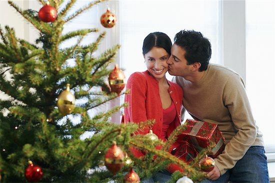 Couple Celebrating Christmas Stock Photo - Premium Rights-Managed, Artist: Jerzyworks, Image code: 700-00547271