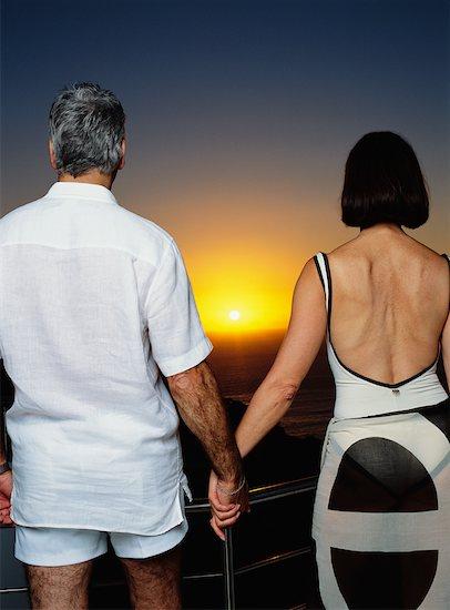 Couple on Balcony Stock Photo - Premium Rights-Managed, Artist: Masterfile, Image code: 700-00557066