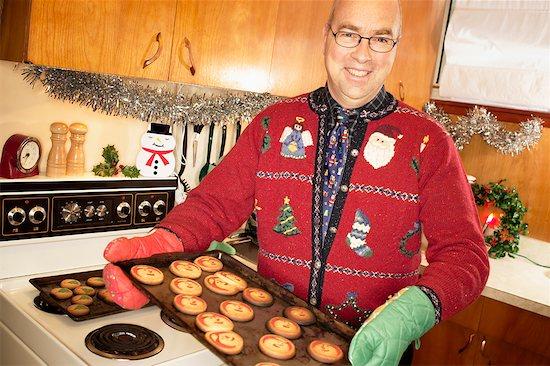 Man Baking Christmas Cookies Stock Photo - Premium Rights-Managed, Artist: Matthew Plexman, Image code: 700-00620340