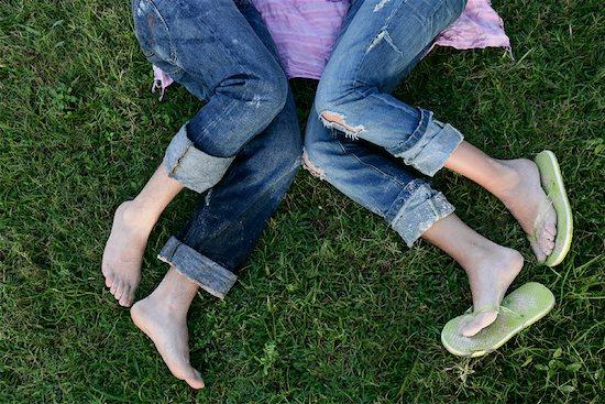 Couple Lying on Grass Stock Photo - Premium Rights-Managed, Artist: Siephoto, Image code: 700-00918379