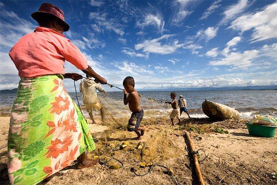 Family Pulling in Fishing Nets, Antongil Bay, Maroantsetra, Madagascar Stock Photo - Premium Rights-Managed, Artist: R. Ian Lloyd, Image code: 700-01112707