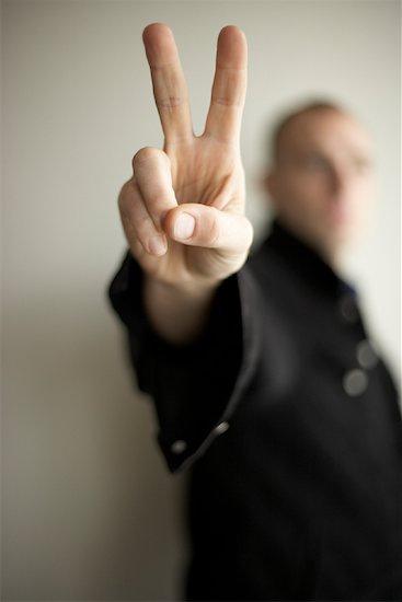 Man Making Peace Sign Stock Photo - Premium Rights-Managed, Artist: Derek Shapton, Image code: 700-01195325