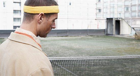 Portrait of Man on Tennis Court Stock Photo - Premium Rights-Managed, Artist: Noel Hendrickson, Image code: 700-01695258
