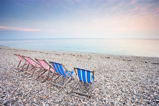 Folding Chairs on Beach, Beer, Devon, England Stock Photo - Premium Rights-Managed, Artist: Tim Hurst, Image code: 700-01953810