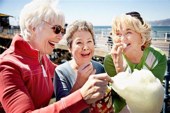 Women Eating Cotton Candy, Santa Monica Pier, Santa Monica, California, USA Stock Photo - Premium Rights-Managed, Artist: Blue Images Online, Image code: 700-02081977