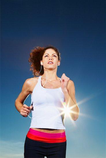 Woman Running and Listening to MP3 Player Stock Photo - Premium Rights-Managed, Artist: Artiga Photo, Image code: 700-02194077