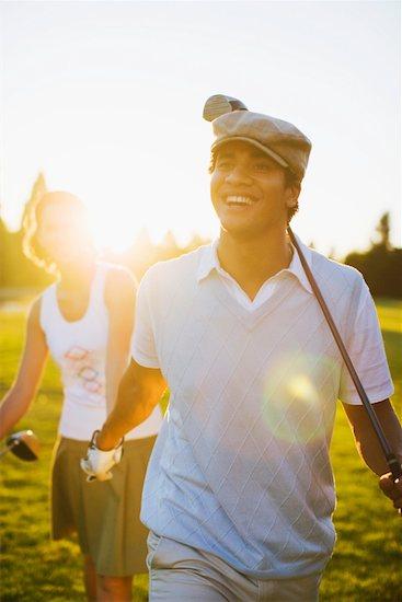 Couple Playing Golf, Salem, Oregon, USA Stock Photo - Premium Rights-Managed, Artist: Ty Milford, Image code: 700-02257773