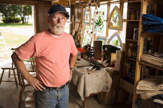 Portrait of Man in Furniture Repair Workshop Stock Photo - Premium Rights-Managed, Artist: George Remington, Image code: 700-02377922