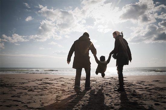 Family on Beach in Winter, Lazio, Rome, Italy Stock Photo - Premium Rights-Managed, Artist: Siephoto, Image code: 700-02757162
