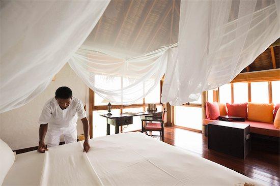 Room Attendant Making Bed, Soneva Gili Resort, Lankanfushi Island, North Male Atoll, Maldives Stock Photo - Premium Rights-Managed, Artist: R. Ian Lloyd, Image code: 700-03244249