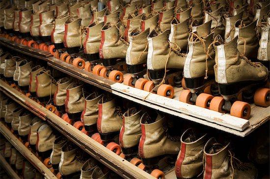 Row of Roller Skates on Shelf Stock Photo - Premium Rights-Managed, Artist: Grant Harder, Image code: 700-03290040