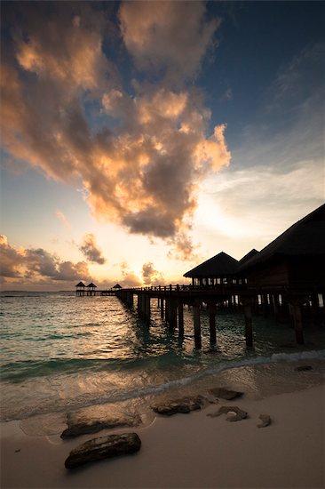 Wharf and Beach Huts at Sunset, The Beach House at Manafaru, Maldives Stock Photo - Premium Rights-Managed, Artist: R. Ian Lloyd, Image code: 700-03403859