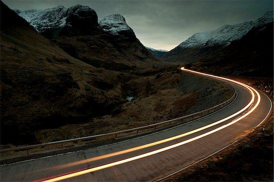 Trail of Car Lights at Dusk Through Mountainous valley, Glencoe, Scotland Stock Photo - Premium Rights-Managed, Artist: JW, Image code: 700-03768718