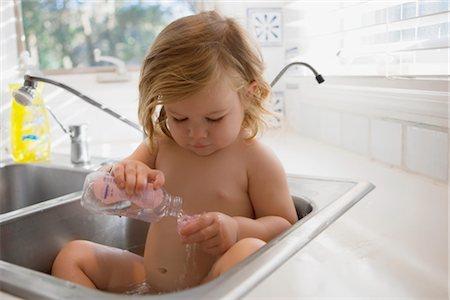 Washing baby bottle Stock Photos - Page 1 : Masterfile