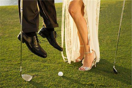 6ecf46f4ffab sports woman in high heels - Two golfers playing golf in a golf  course