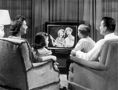 Retro tv watching Stock Photos - Page 1 : Masterfile