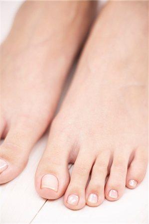 Neutral toe nail polish Stock Photos - Page 1 : Masterfile